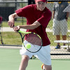 Joplin's Nick Mailes returns a volley during his district match on Tuesday at JHS.<br /> Globe | Laurie Sisk