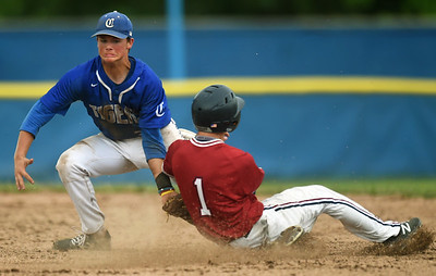 Carthage shortstop Kaden Kralicek applies the  tag as he catches Joplin's Jacob Yarnall on an attempted steal during their Class 5 District 12 championship game on Tuesday night at Carthage's Carl Lewton Stadium. Globe | Laurie Sisk