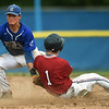Carthage shortstop Kaden Kralicek applies the  tag as he catches Joplin's Jacob Yarnall on an attempted steal during their Class 5 District 12 championship game on Tuesday night at Carthage's Carl Lewton Stadium.<br /> Globe | Laurie Sisk