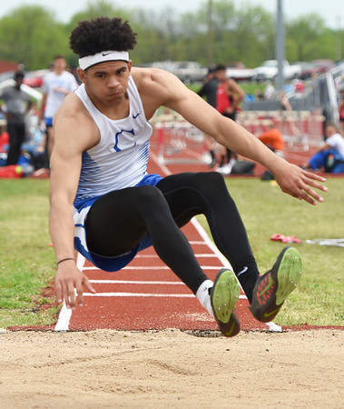 Carthage's Arkel Smith competes in the triple jump during the Central Ozarks Conference meet on Friday at Webb City.<br /> Globe   Laurie Sisk