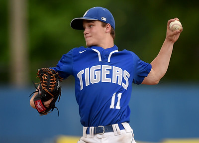Carthage starter Trason Vogt delivers a pitch to the plate during a Class 5 District 12 championship game on Tuesday night at Carthage's Carl Lewton Stadium. Globe | Laurie Sisk