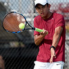 Joplin's Gustavo Garcia returns a serve during his district match on Tuesday at JHS.<br /> Globe | Laurie Sisk