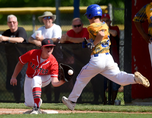 Baxter Springs first baseman Zak Beeler gets the force out on Parsons senior Gavynn Larson during their semifinal substate game on Thursday at Parsons.<br /> Globe | Laurie Sisk 3