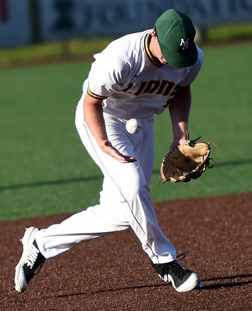 Missouri Southern third baseman Joe Kinder gets control of a hard hit gounder during the Lions' game against Fort Hays State on Friday night at Warren Turner Field.<br /> Globe | Laurie Sisk