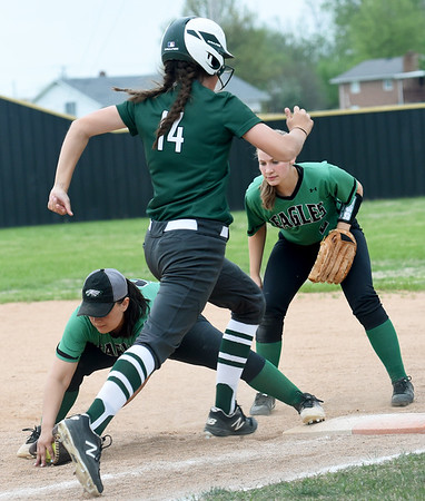 Pierce City first baseman Peighton Maddock stretches for the out on Mount Vernon's Kassidy Anderson as teammate Donielle Brottlund backs up the play during their Class 1 District 11 championship game on Wednesday at Sarcoxie High School.<br /> Globe | Laurie Sisk