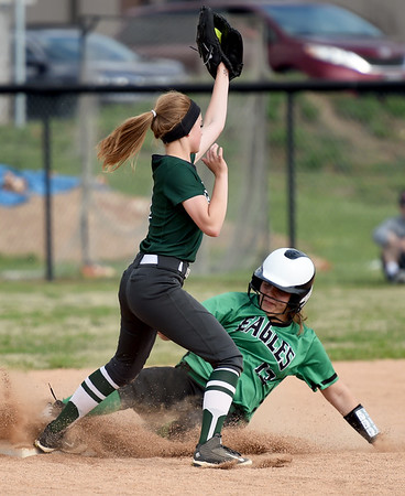 Pierce City's Kendyl Hayward slides safely into second base as Mount Vernon infielder Raelin Swillum fields the throw during their Class 1 District 11 championship game on Wednesday at Sarcoxie High School.<br /> globe | Laurie Sisk