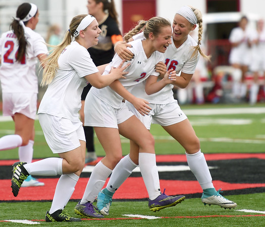 Webb City sophomore Allison Cundy, center, celebrates with teammates after a first period goal during the Cardinals' District 12 championship game against Neosho on Wednesday at Cardinal Stadium. Pictured from the left: McKenzie Brown, Cundy and Lily Spikereit.<br /> Globe | Laurie SIsk