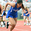 McAuley's Johanna Damaso competes on the first leg of the girls 4x100m relay on Saturday at Carl Junction.<br /> Globe | Laurie Sisk