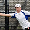 Carthage's Seth Dixon stretches to return a serve during his doubles match with teammate Thomas Neuenswander against the Joplin duo of Garrett Lewis and Gustavo Garcia on Tuesday at JHS.<br /> Globe | Laurie Sisk
