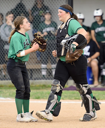 Pierce City catcher Ali Raley, right, chats with teammate Jaclin Fenske during their game Class 1 District 11 championship game on Wednesday at Sarcoxie.<br /> Globe   Laurie Sisk