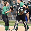 Pierce City catcher Ali Raley, right, chats with teammate Jaclin Fenske during their game Class 1 District 11 championship game on Wednesday at Sarcoxie.<br /> Globe | Laurie Sisk