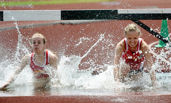 From the left: Pittsburg State's Paige Denton and Christina Metzger compete in the 3,000m steeplechase during the MSSU Last Chance meet on Friday at Missouri Southern.<br /> Globe   Laurie SIsk
