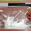 From the left: Pittsburg State's Paige Denton and Christina Metzger compete in the 3,000m steeplechase during the MSSU Last Chance meet on Friday at Missouri Southern.<br /> Globe | Laurie SIsk