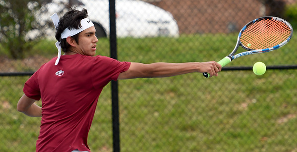 Joplin's Gustavo Garcia stretches to backhand a service return during his doubles match with teammate Garrett Lewis against the Carthage duo of Thomas Neuenswander and Seth Dixon on Tuesday at JHS.<br /> Globe | Laurie Sisk