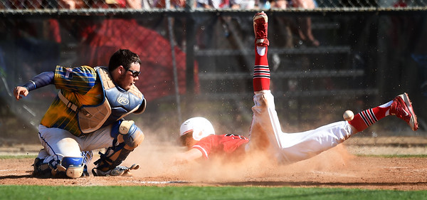 Baxter Springs senior Brant Trease jars the ball loose from Parsons catcher Connor Eichinger during their semifinal substate game on Thursday at parsons. Globe | Laurie Sisk