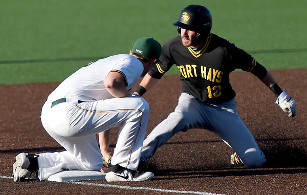 Missouri Southern third baseman Joe Kinder thwarts an attempted steal as he applies the tag on Fort Hays State's Clayton Bagsall during their game on Friday night at Warren Turner Field.<br /> Globe   Laurie Sisk