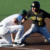 Missouri Southern third baseman Joe Kinder thwarts an attempted steal as he applies the tag on Fort Hays State's Clayton Bagsall during their game on Friday night at Warren Turner Field.<br /> Globe | Laurie Sisk