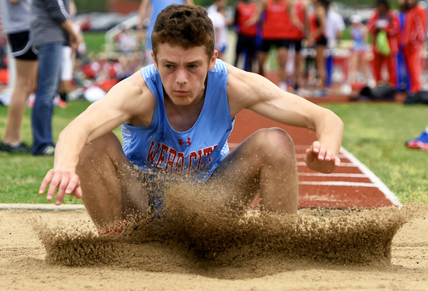 Webb City's Dakota Wynn leaps to a career best mark in the triple jump during the Central Ozarks Conference meet on Friday at Webb City.<br /> Globe | Laurie Sisk