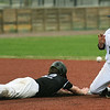 Mineral Area's Caleb Feuerstake slides safely into second base as Crowder's Cooper King attempts to field the throw during their game on Friday at Joe Becker.<br /> Globe | Laurie SIsk