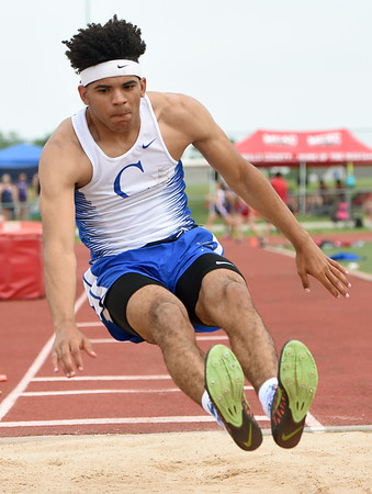 Carthage long jumper Arkel Smith competes in the Class 4 District 6 meet on Saturday at Carl Junction.<br /> Globe   Laurie Sisk