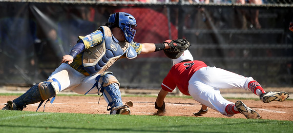 Baxter Springs sophomore Caleb Arnall slides safely under the tag of Parsons catcher Connor Eichinger during their semifinal substate game on Thursday at Parsons.<br /> Globe | Laurie Sisk