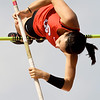 Carl Junction's Lily Pyle tries to best teammate Logan Hurt in the pole vault during the Class 4 District 6 meet on Saturday at Carl Junction.<br /> Globe | Laurie Sisk