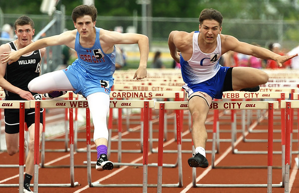 Carthage hurdler Dillon Lancaster, right, edges out Webb City's Jake Ogden for the boys hurdle title during the Central Ozarks Conference meet on Friday at Webb City.<br /> Globe | Laurie Sisk
