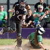 Pierce City's Lexi Eck slides safely into home as Mount Vernon catcher Harper Looney fields the throw during their Class 1 District 11 championship game on Wednesday at Sarcoxie High School.<br /> globe | Laurie Sisk