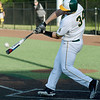 Missouri Southern's Alex Phillips makes contact with a pitch during the Lions' game against Fort Hays State on Friday night at Warren Turner Field.<br /> Globe | Laurie Sisk