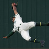 Missouri Southern's Mike Million makes a diving catch in deep centerfield during the Lions game against Central Oklahoma on Friday at Pittsburg State's Al Ortolani Field.<br /> Globe | Laurie Sisk