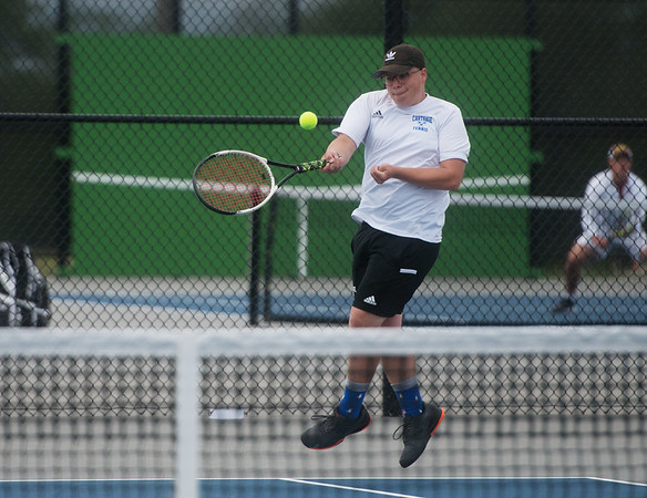 Carthage's Jaben Parnell returns a shot during district tennis play on Friday in Carthage.<br /> Globe | Roger Nomer