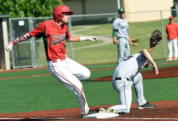 From the left: Liberal's joseph Clark beats the ball to first base as College Heights first baseman Bryce Jackson gloves the throw during their Class 2 District 7 championship game on Tuesday at Wendell Redden Field.<br /> Globe | Laurie Sisk