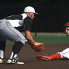 Webb City's Blake Smith (10) slides safely under the tag of Willard's Garrett Rice (5) during their Class 5 Sectional game on Tuesday at Warren Turner Field.<br /> Globe | Laurie Sisk