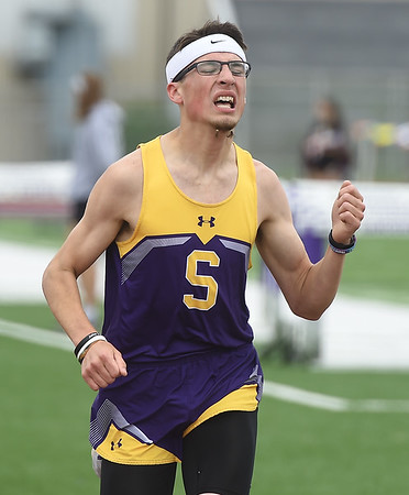 Sarcoxie's Wyatt Graff rides a strong finish for a second place showing in the 1600m during Class 2 District 5 Track and Field on Saturday at Sarcoxie High School. Globe | Laurie Sisk