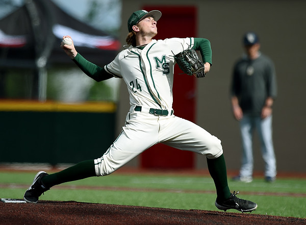 Missouri Southern's Will Bausinger delivers a pitch to the plate during the Lions game against Central Oklahoma on Friday at Pittsburg State's Al Ortolani Field.<br /> Globe | Laurie Sisk