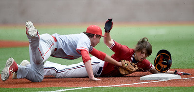 Carl Junction third baseman Carson Johnson, left, tags out Joplin's Holden Ledford during their game on Wednesday at JHS. Globe | Laurie SIsk