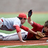 Carl Junction third baseman Carson Johnson, left, tags out Joplin's Holden Ledford during their game on Wednesday at JHS.<br /> Globe | Laurie SIsk