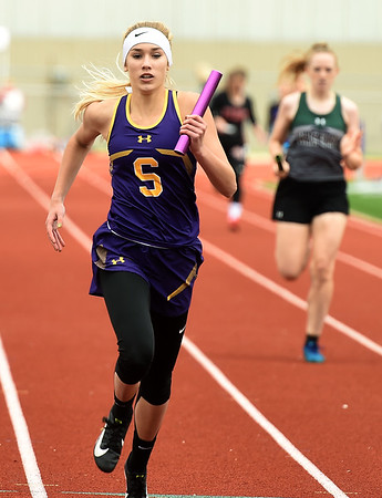 Sarcoxie's McKenna Bass secures a first place finish for the Sarcoxie 4x200 relay team during Class 2 District 5 Track and Field on Saturday at Sarcoxie High School. Globe | Laurie Sisk
