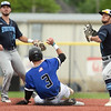 Crowder's Cameron Tissue (3) tries to break up a double play as State Fair's Brett Holden throws to first base during their Region XVI Division I game on Thursday at Joe Becker Stadium. Also pictured, left is State Fair's Gavin Jones. <br /> Globe | Laurie Sisk