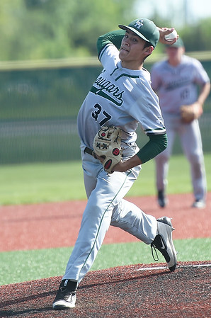 College Heights starter Clay Sitton delivers a pitch to the plate during the Cougars Class 2 District 7 championship game against Liberal on Tuesday at Wendell Redden Field.<br /> Globe | Laurie Sisk