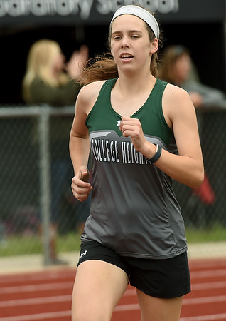 College Heights sophomore Grace Bishop runs to a third place finish in the 1600m during Class 2 District 5 Track and Field on Saturday at Sarcoxie High School. Bishop went to state as a freshman, but missed most of this season because of an injury.<br /> Globe | Laurie Sisk