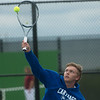 Carthage's Adam Theis returns a shot during district tennis play at Carthage on Friday.<br /> Globe | Roger Nomer