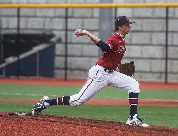 Joplin's Josh Wells delivers a pitch against McDonald County during Saturday's district game in Joplin.<br /> Globe | Roger Nomer