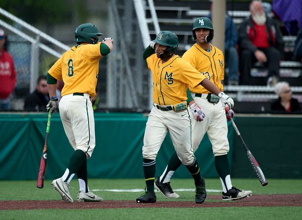 Missouri Southern's Troy Gagan (8) welcomes home Mike Million after his game-tying homerun during Sunday's MIAA tournament game against the University of Central Missouri at Pittsburg State University.<br /> Globe | Roger Nomer