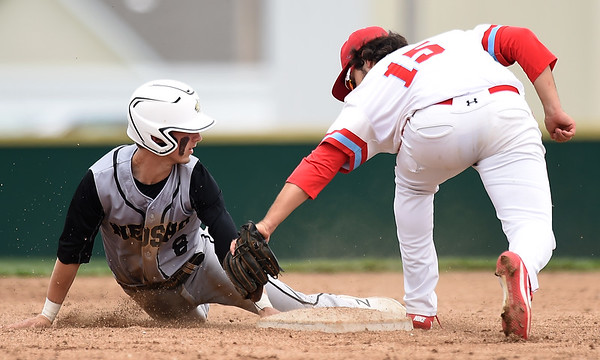 Neosho's Kaden Dickens (8) slides safely into second base as Webb City's Zach Biastock (15) applies the tag during their game on Friday at Webb City.<br /> Globe | Laurie SIsk