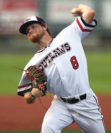 Outlaws starter Dalton Weaver delivers a pitch to the plate during the Outlaws home opener against the Midwest Nationals on Friday night at Joe Becker Stadium.<br /> Globe | Laurie Sisk