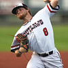 Outlaws starter Dalton Weaver delivers a pitch to the plate during the Outlaws home opener against the Midwest Nationals on Friday night at Joe Becker Stadium.<br /> Globe   Laurie Sisk