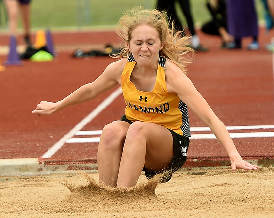 Diamond's Jacey Starks competes in the long jump during Class 2 District 5 Track and Field on Saturday at Sarcoxie High School.<br /> Globe | Laurie Sisk