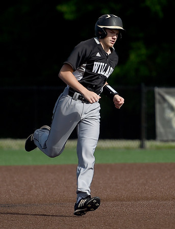 Willard junior Cole Biellier rounds the bases after a solo home run during the Tigers Class 5 Sectional game against Webb City on Tuesday at Warren Turner Field.<br /> Globe | Laurie Sisk