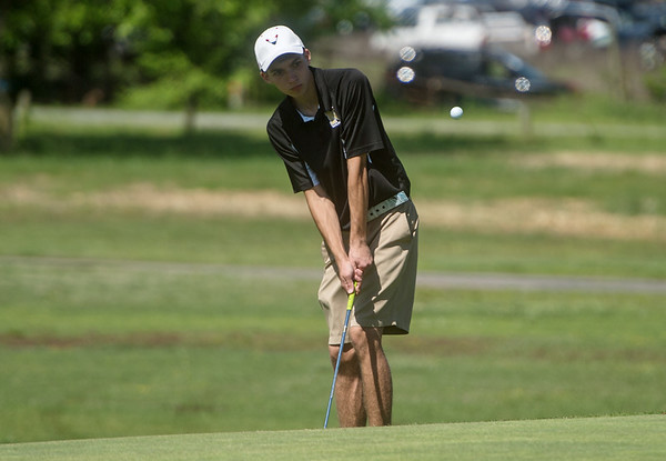Neosho's Derrick Olsbo chips onto the green during sectional play at Schifferdecker Golf Course on Monday.<br /> Globe   Roger Nomer